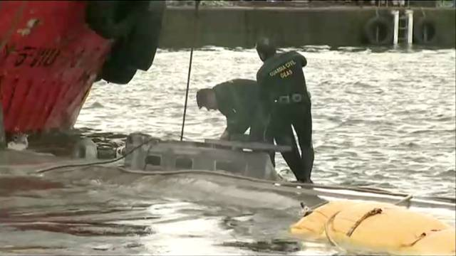 A suspected drug submarine believed to be carrying cocaine is refloated at a port in Aldan