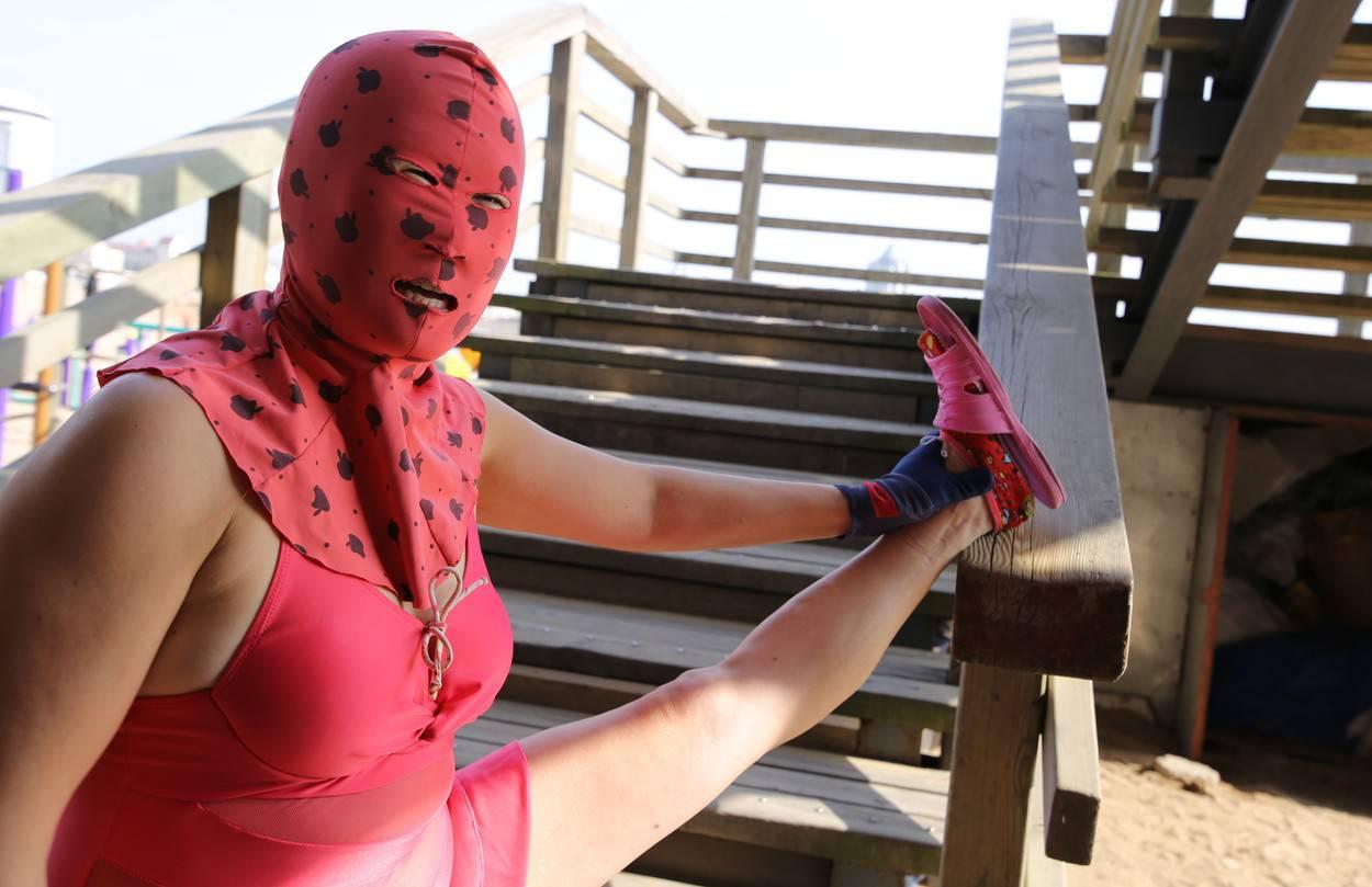 Woman wearing a facekini, Tsingtao, China - 29 Mar 2016