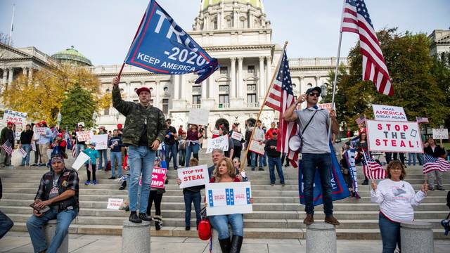 Supporters of U.S. President Donald Trump protest in front of the Pennsylvania Commonwealth capitol building in Harrisburg