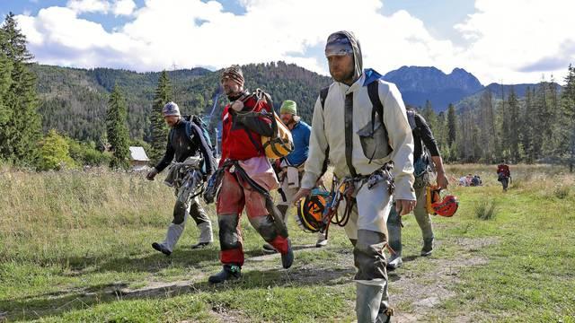 Mountain rescue team (TOPR) members return from a search mission in Zakopane