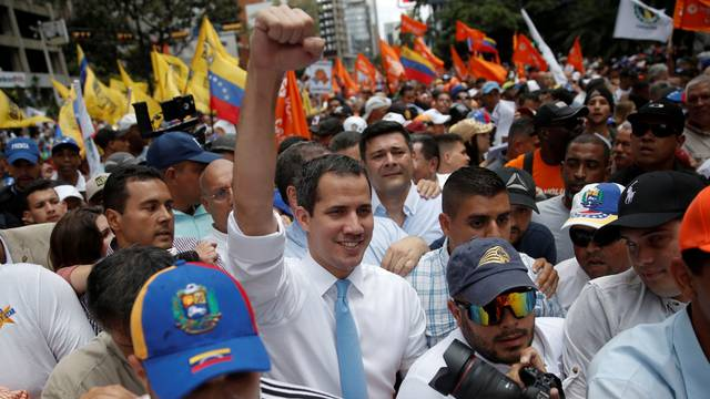 Venezuela's National Assembly President and opposition leader Juan Guaido, who many nations have recognised as the country's rightful interim ruler, takes part in a demonstration in Caracas