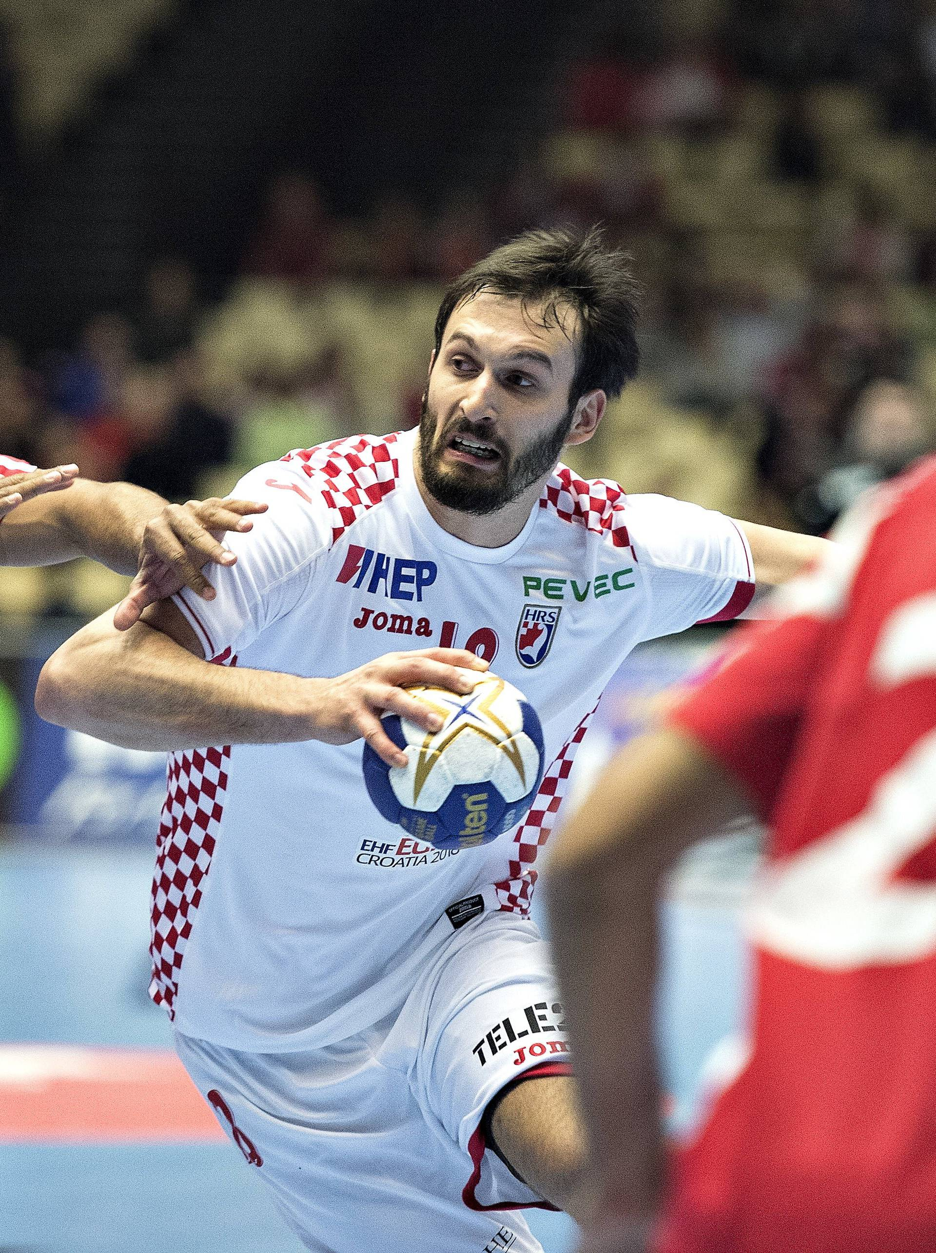 Habib Mohamed of Bahrain and Igor Karaci of Croatia in action during their men's handball Olympic qualification match in Boxen