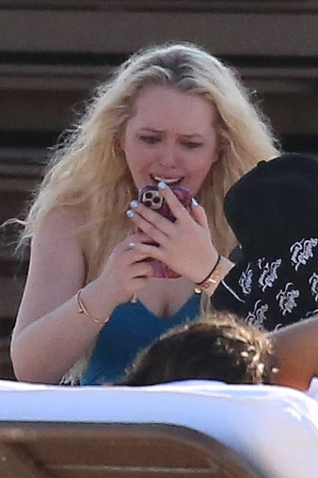 *NO WEB UNTIL 1500 EDT 15TH OCT PREMIUM EXCLUSIVE* Tiffany Trump wears a blue swimsuit and appears to go through a range of emotions as she relaxes on the beach with friends on her birthday in Miami