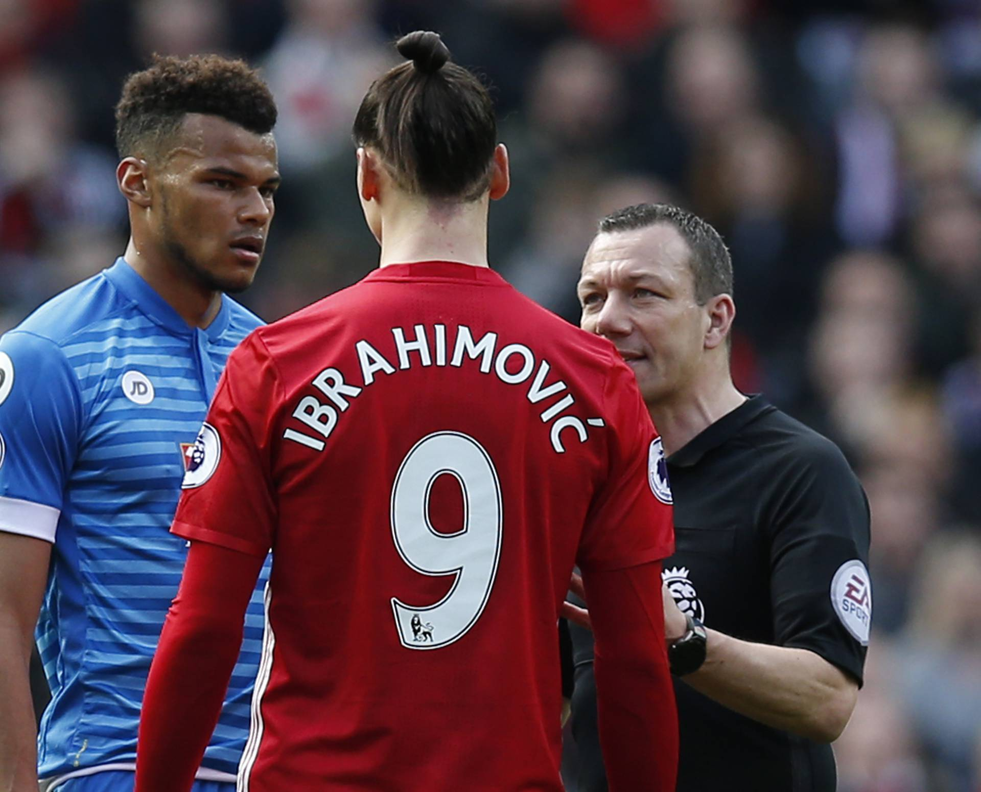 Manchester United's Zlatan Ibrahimovic and Bournemouth's Tyrone Mings are spoken to by referee Kevin Friend