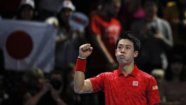 Japan's Kei Nishikori celebrates after winning his round robin match against Switzerland's Stanislas Wawrinka