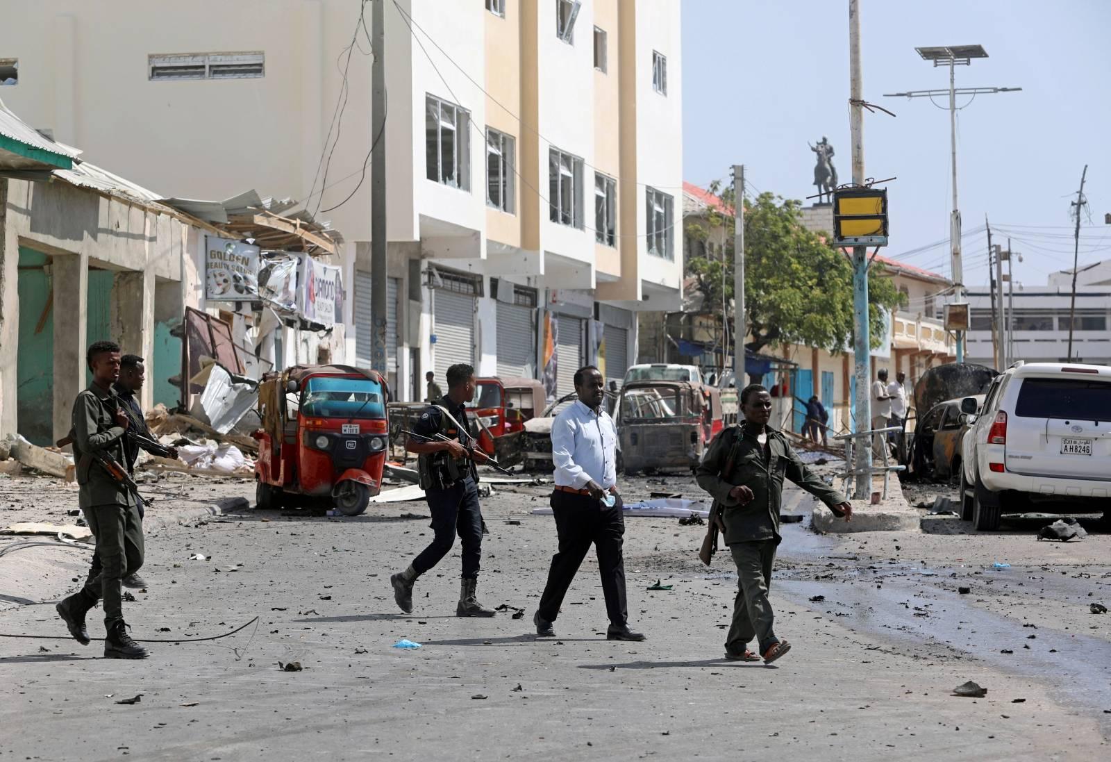 Somali policemen secure the scene of a bomb explosion at the Maka al-Mukarama street in Mogadishu