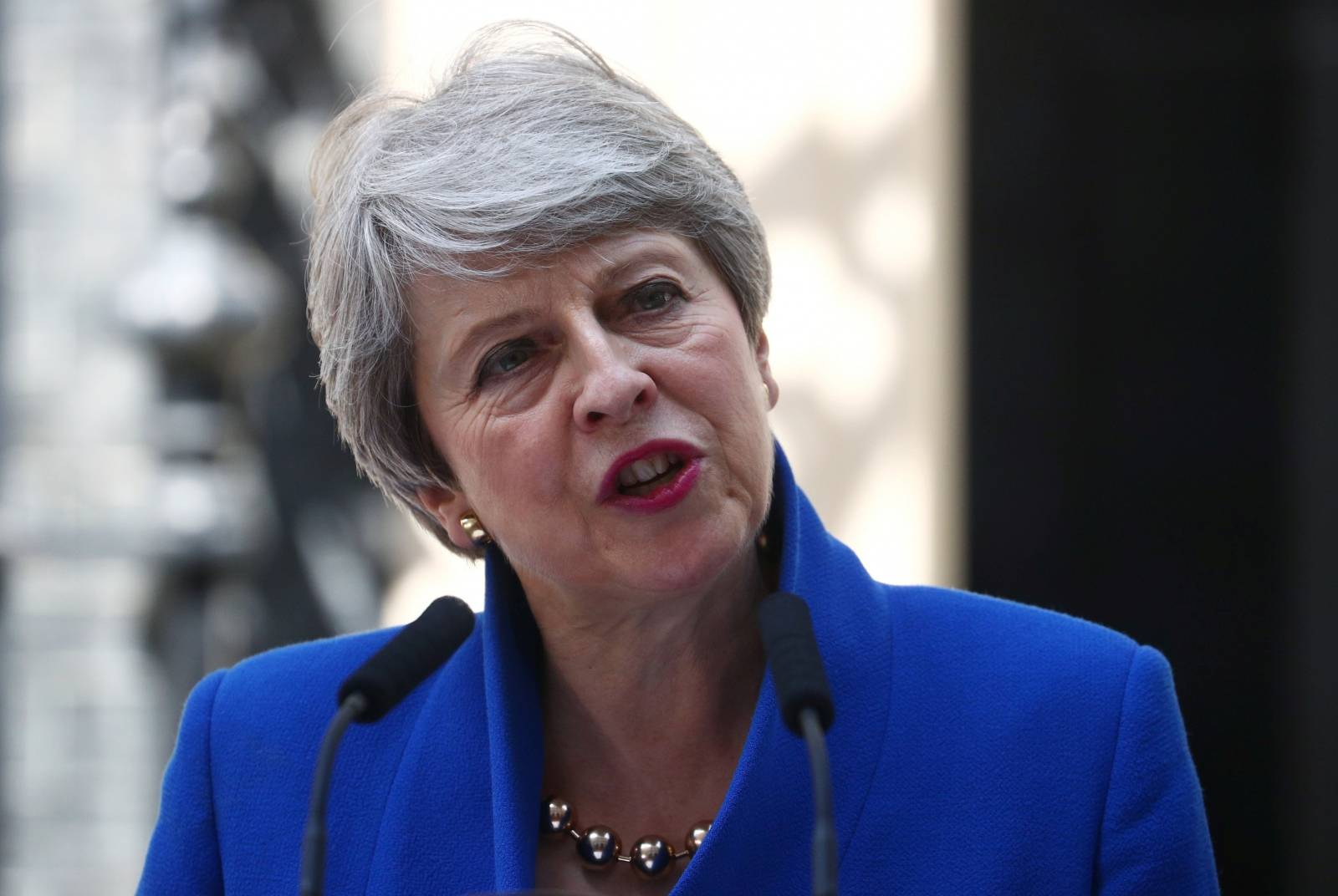 Theresa May delivers a speech on her last day in office as Britain's Prime Minister, outside Downing Street, in London