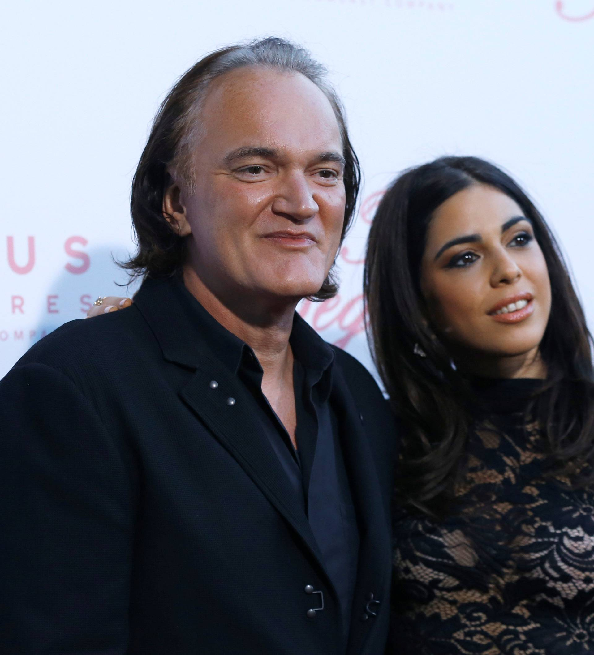 "Director Tarantino and Daniela Pick pose at a premiere for ""The Beguiled"" in LA"