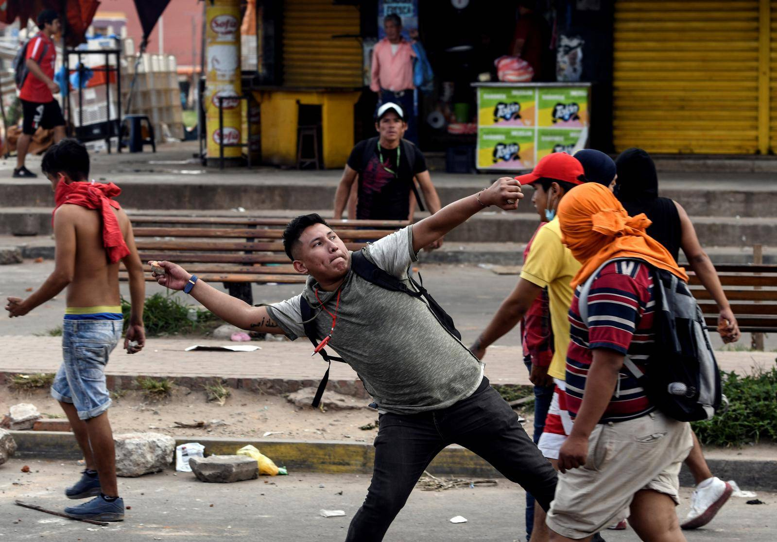 A demonstrator throws a stone during clashes in Santa Cruz