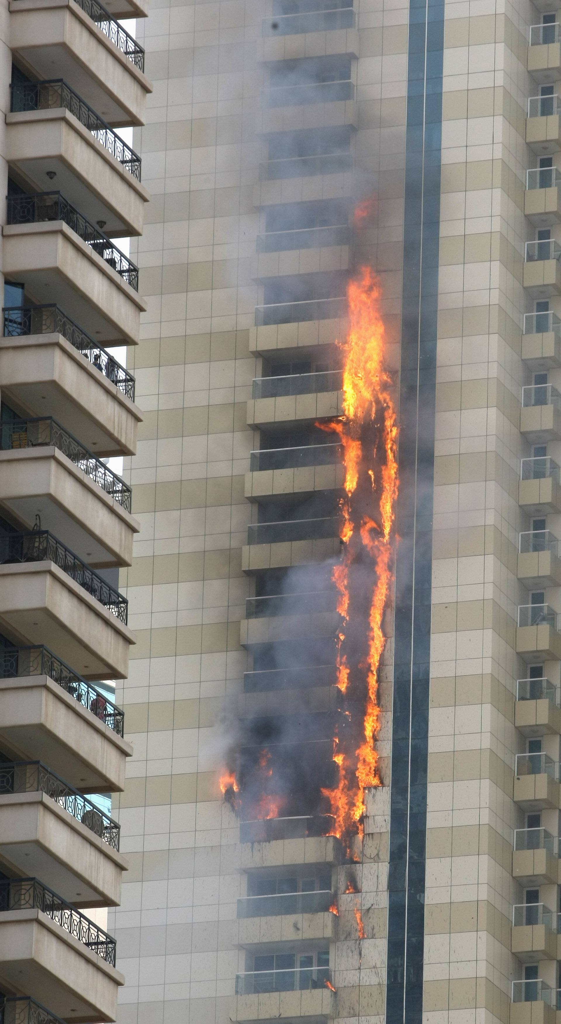 Flames are seeen after a fire broke out at residential Sulafa tower in the upscale Marina district in Dubai