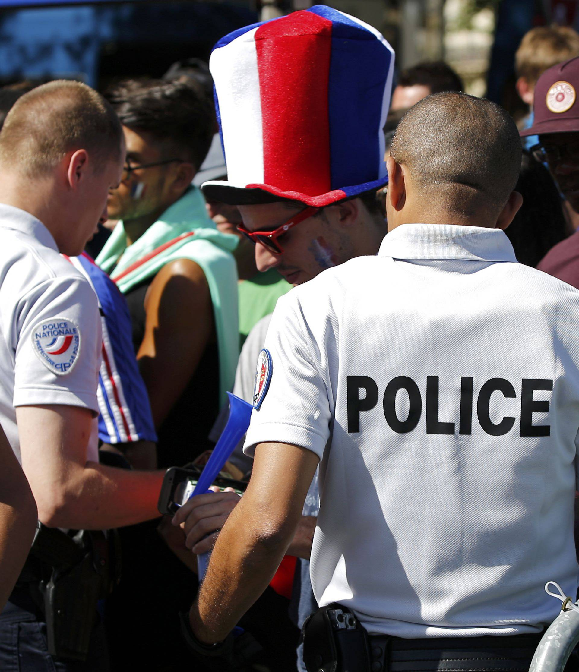 Security check near the Paris fan zone during a EURO 2016 final soccer match
