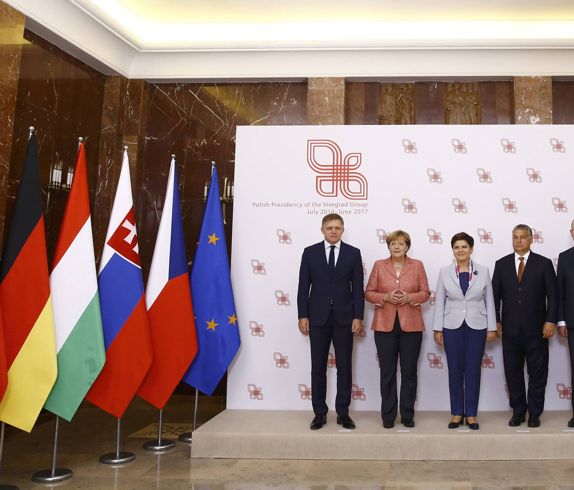 Slovakia's PM Fico, German Chancellor Merkel, Poland's PM Szydlo, Hungary's PM Orban and Czech Republic's PM Sobotka pose for media in Warsaw