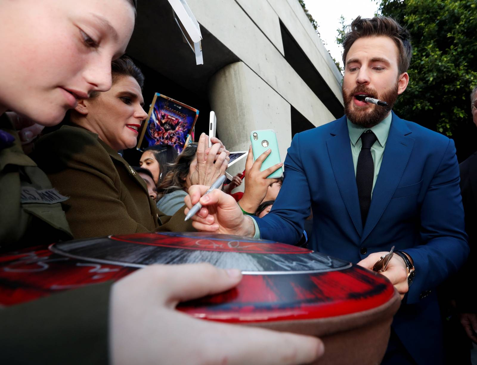 """Cast member Chris Evans signs autographs for fans on the red carpet at the world premiere of the film """"The Avengers: Endgame"""" in Los Angeles"""