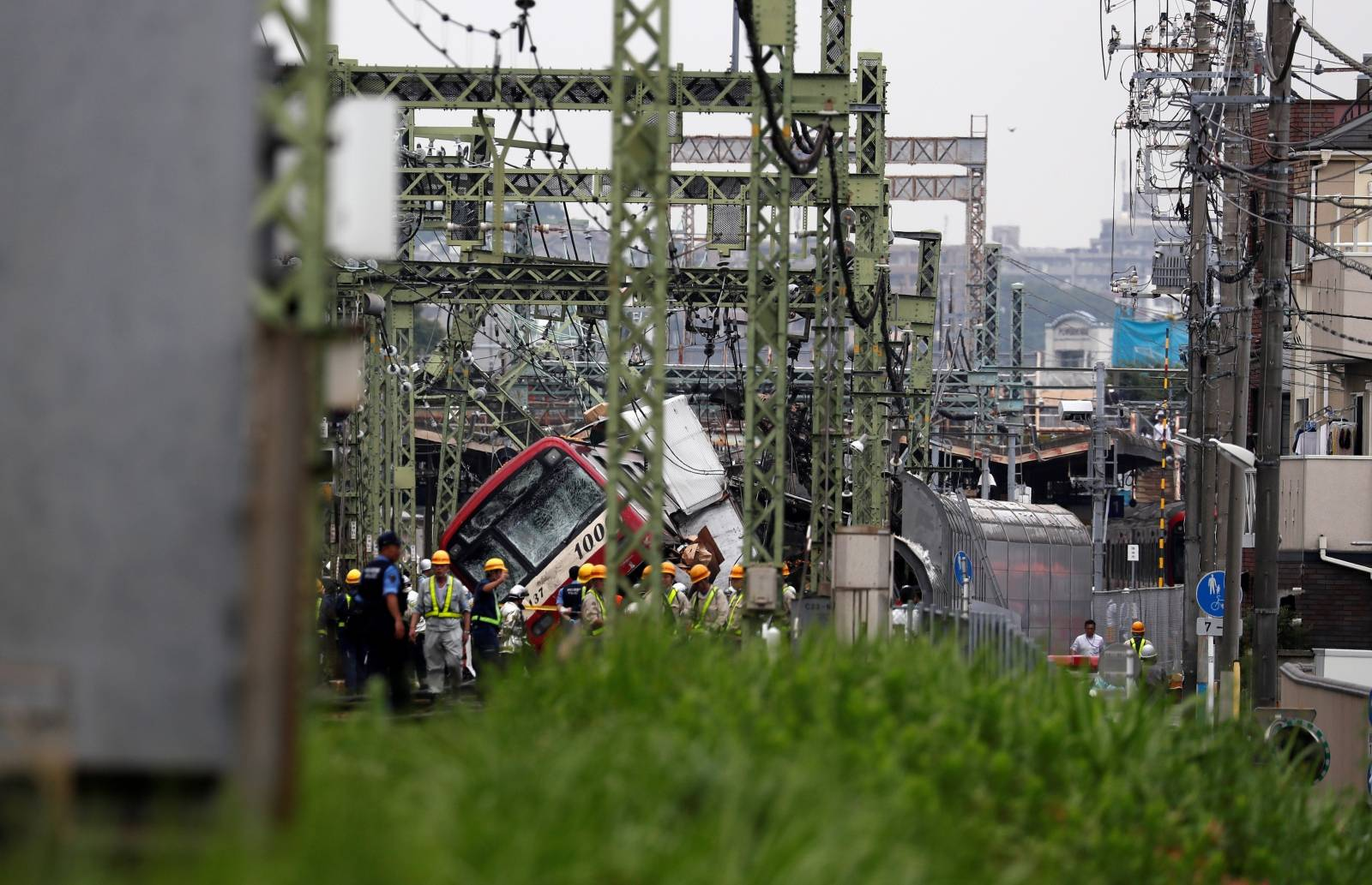A train is seen derailed after a collision with a truck in Yokohama, near Tokyo, Japan