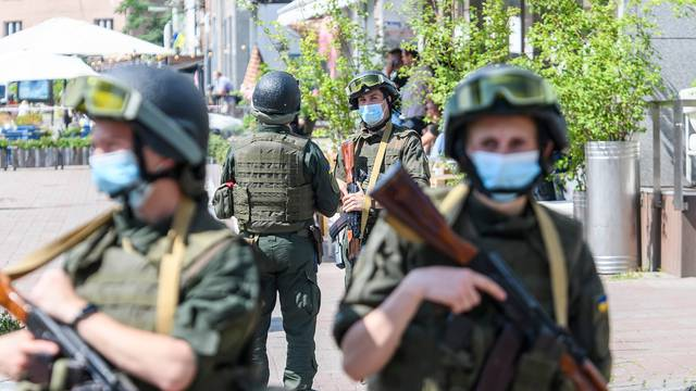 SBU and police officers in medical masks during anti-terrorist exercises in Kyiv, Ukraine. July 4, 2021. High quality photo