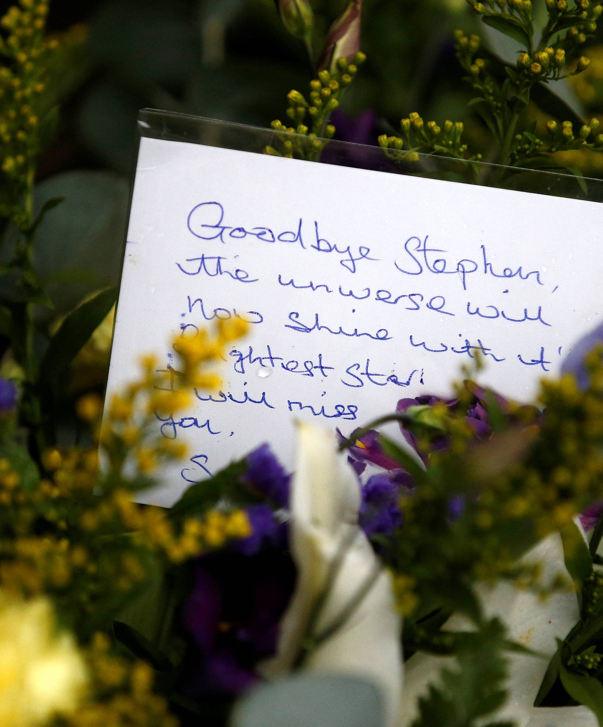 A floral tribute left outside Great St Marys Church, where the funeral of theoretical physicist Prof Stephen Hawking is being held, in Cambridge