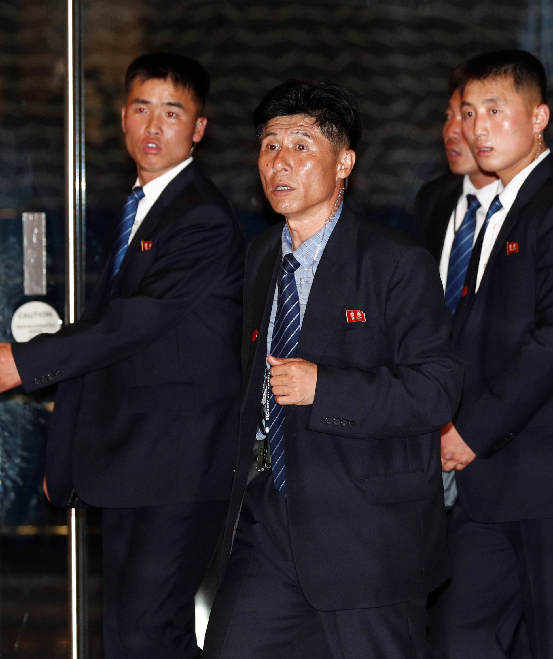 Bodyguards of North Korea's leader Kim Jong Un arrive at The Marina Bay Sands hotel in Singapore