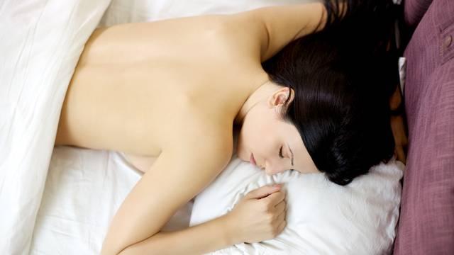 Naked girl sleeping in bed relaxing