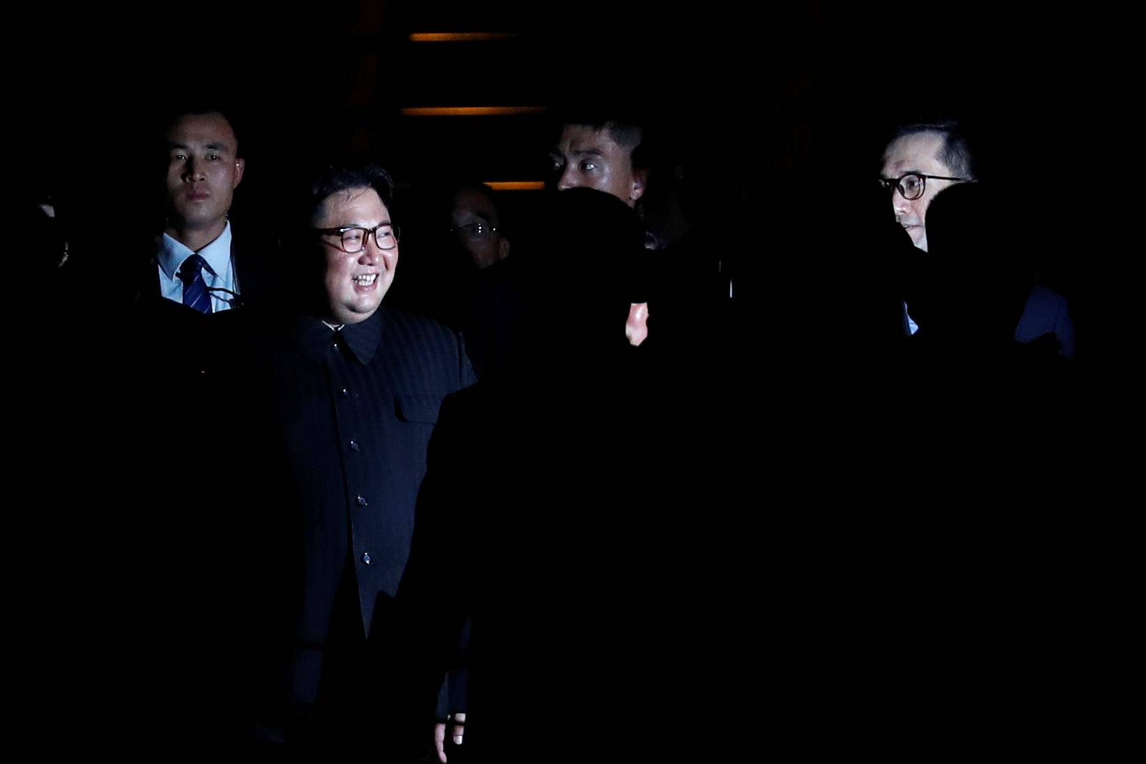 North Korea's leader Kim Jong Un is surrounded by guards as he visits Merlion Park in Singapore