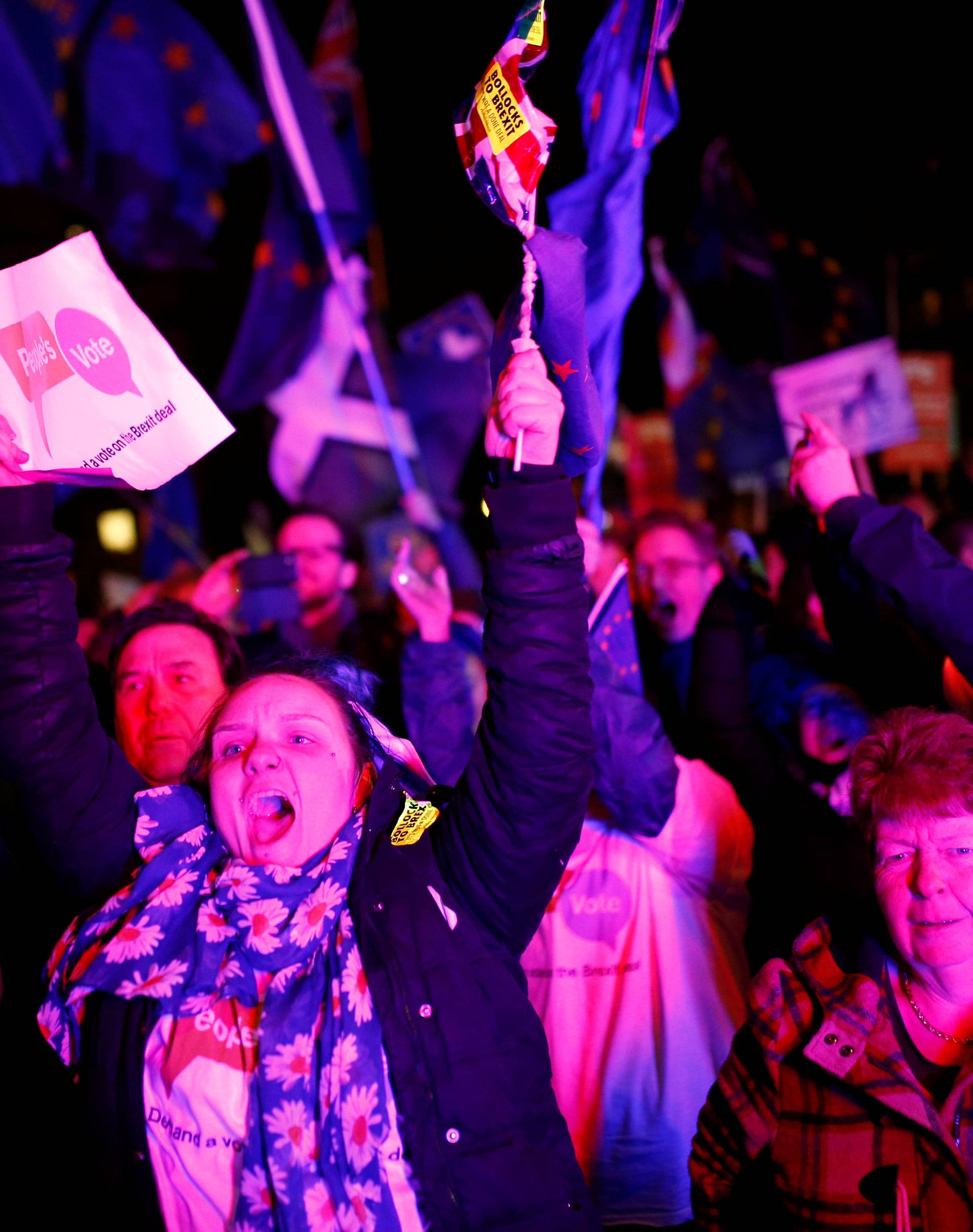 Protesters react after the result was announced on Prime Minister Theresa May's Brexit deal in London