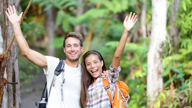 Happy hiking - hikers cheering joyful in forest