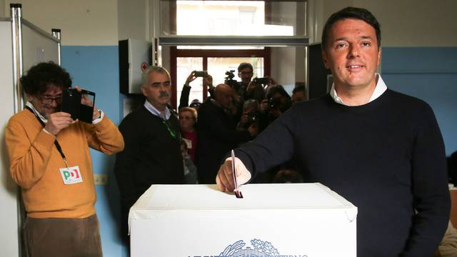 Italian Prime Minister Matteo Renzi casts his vote for the referendum on constitutional reform, in Pontassieve