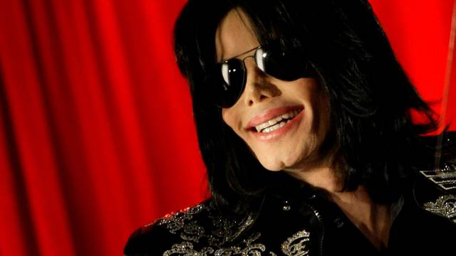 FILE PHOTO: U.S. pop star Michael Jackson gestures during a news conference at the O2 Arena in London