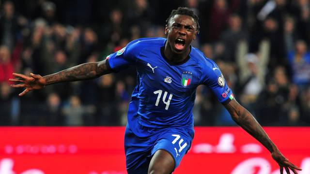 FILE PHOTO: Italy striker Moise Kean celebrates scoring their second goal in a European championship qualifying game against Finland.