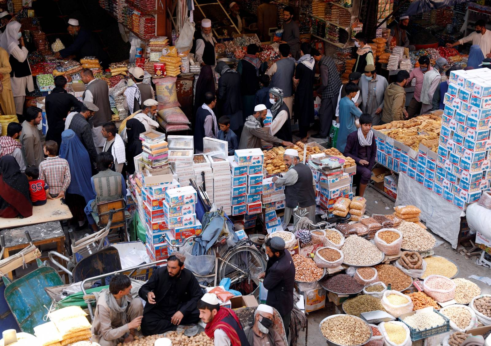 People shop for festive goods in preparation for Eid al-Fitr, marking the end of the fasting month of Ramadan amid the spread of the coronavirus disease (COVID-19), in Kabul