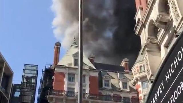 A blaze is seen at the Mandarin Oriental Hotel in Knightsbridge, London