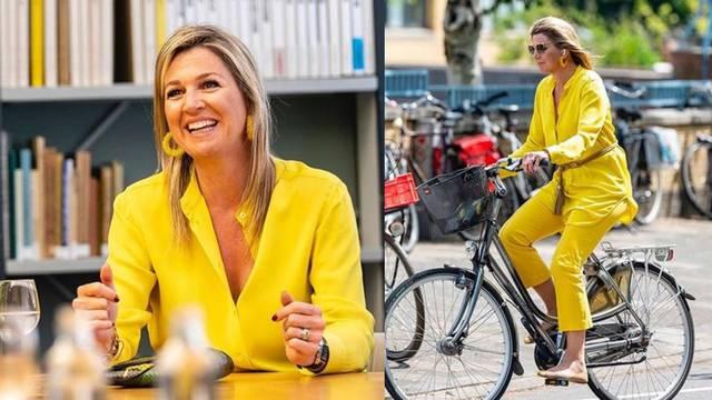 Royal žuta: Kraljica Maxima  na biciklu u odijelu sunčane nijanse
