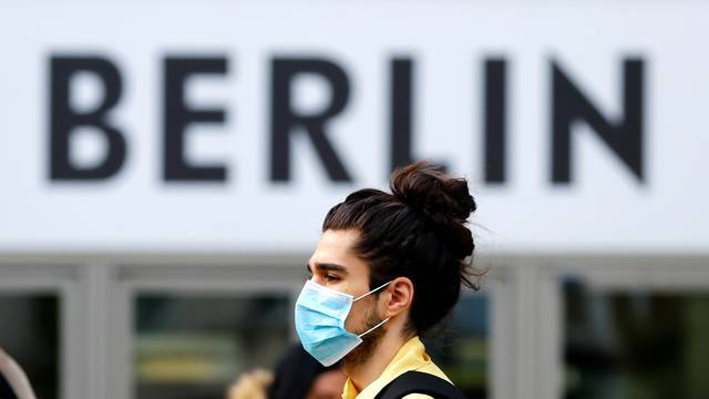 A man wearing a face mask is pictured at Schloss Strasse shopping street as the coronavirus disease (COVID-19) outbreak continues in Berlin