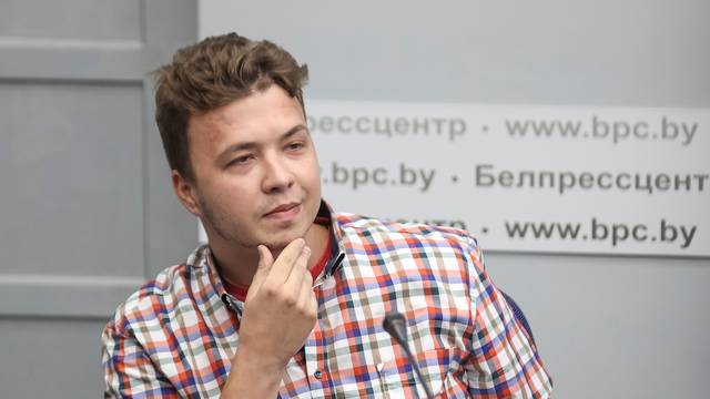 Jailed Belarus journalist Roman Protasevich takes part in a press conference in Minsk