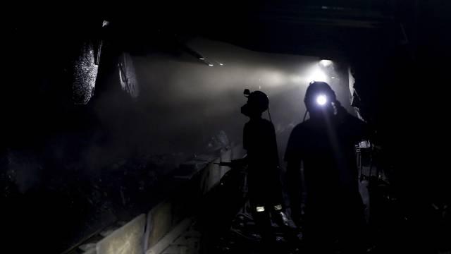 FILE PHOTO: Miners working about 500 meters underground at the Boleslaw Smialy coal mine, a unit of coal miner Kompania Weglowa (KW) in Laziska Gorne
