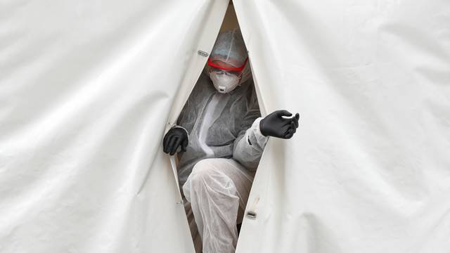 A medical specialist walks out of a mobile laboratory carrying out tests to detect the coronavirus disease in Moscow