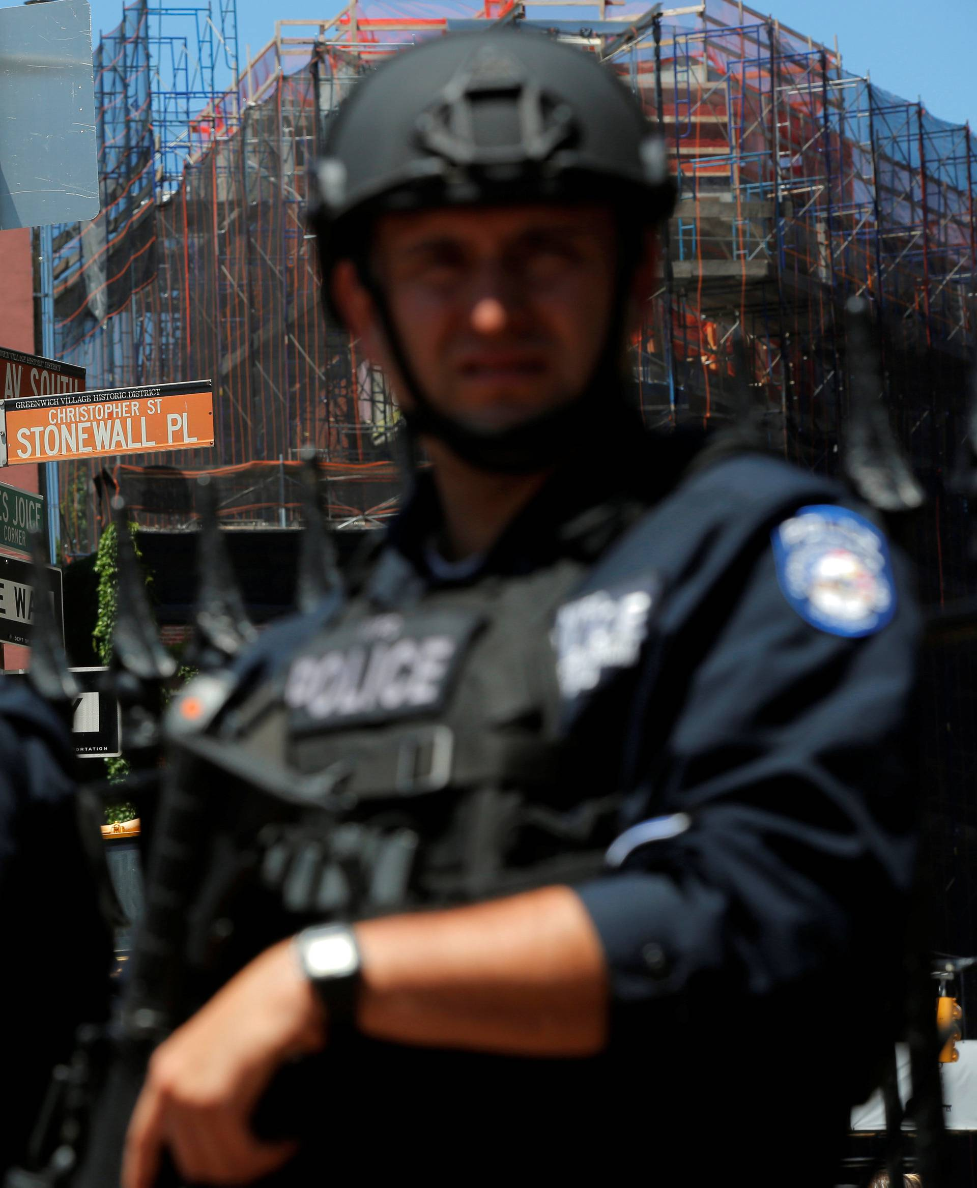 Members of the New York Police Department's Critical Response Command Unit stand guard on Christopher Street, in Manhattan