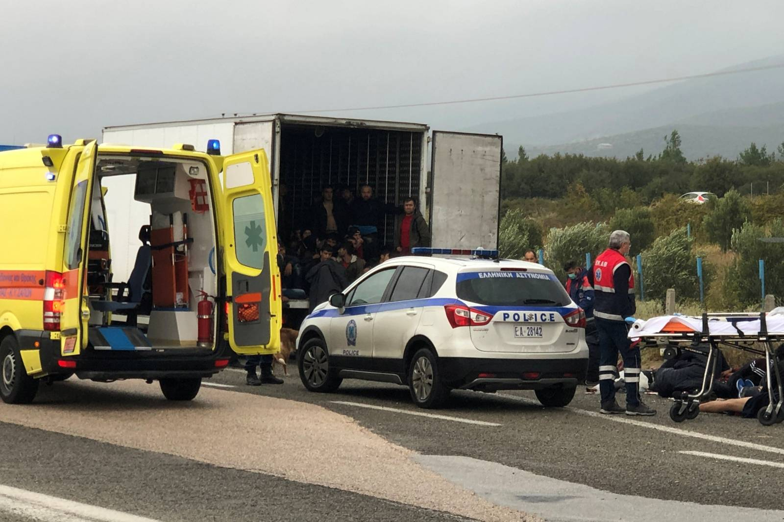 Migrants are seen inside a refrigerated truck found by police, after a check at a motorway near Xanthi