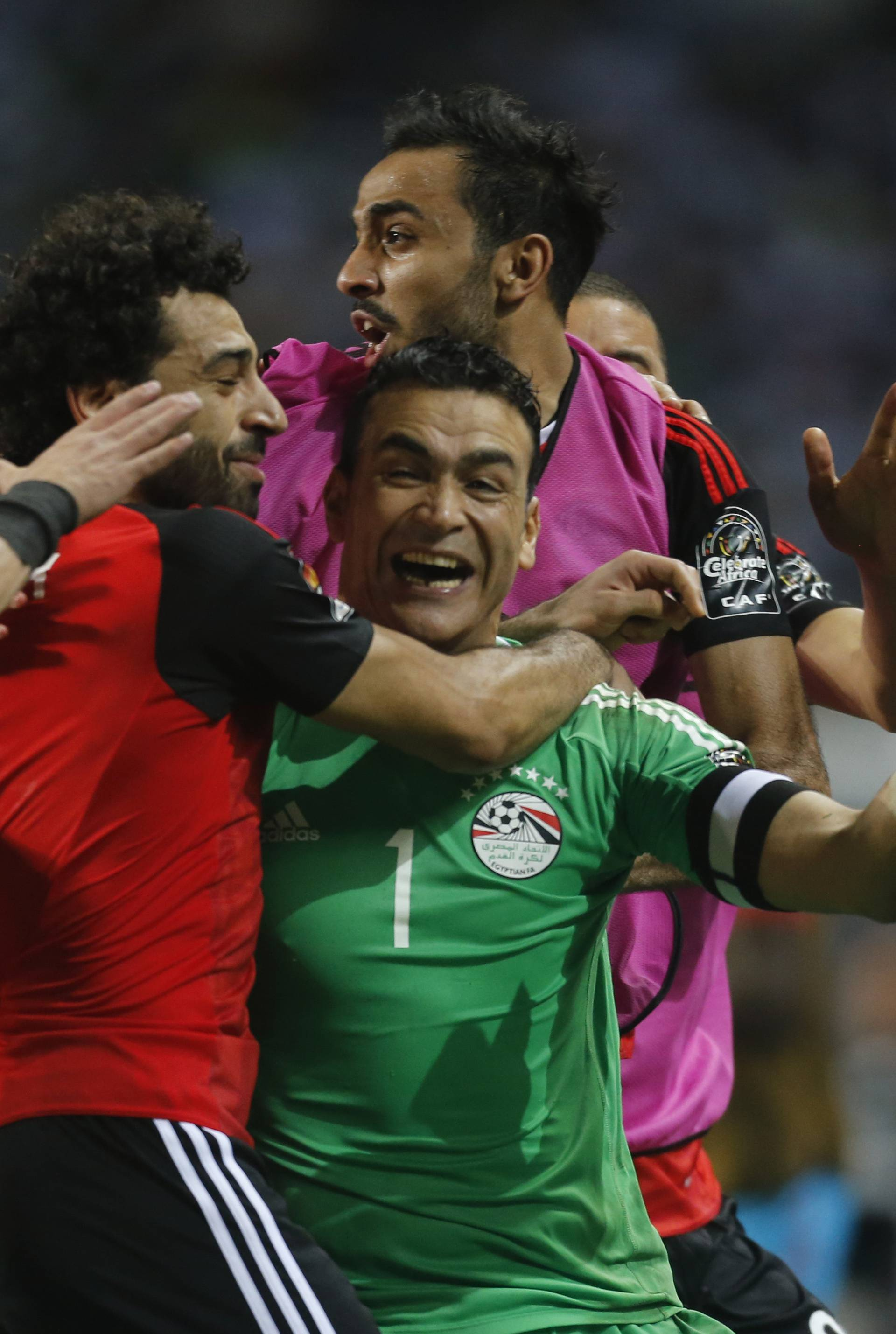 Egypt's Essam El-Hadary celebrates with team mates after the game