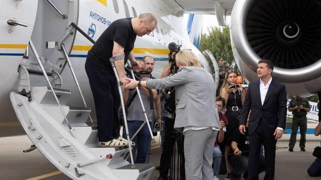 Ukraine's President Volodymyr Zelensky welcomes recently exchanged Ukrainian prisoners upon arrival at Boryspil International Airport, outside Kiev