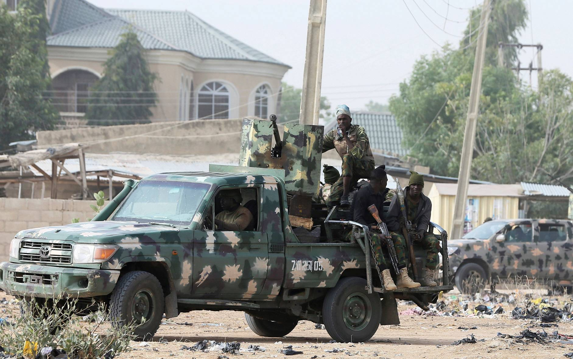 FILE PHOTO: Nigerian military secure an area where a man was killed by suspected militants near Maiduguri