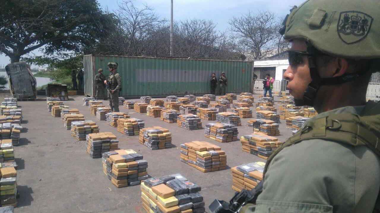 Soldiers stand guard next to packages containing cocaine after Colombian police seized more than six tonnes of the drug, in Barranquilla