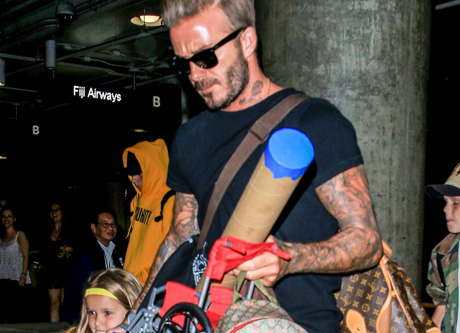 David & Victoria Beckham Catch a Flight Out of LAX With Their Kids