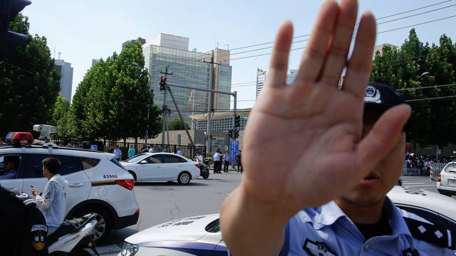 A police officer gestures near the site of a blast outside the U.S. embassy in Beijing
