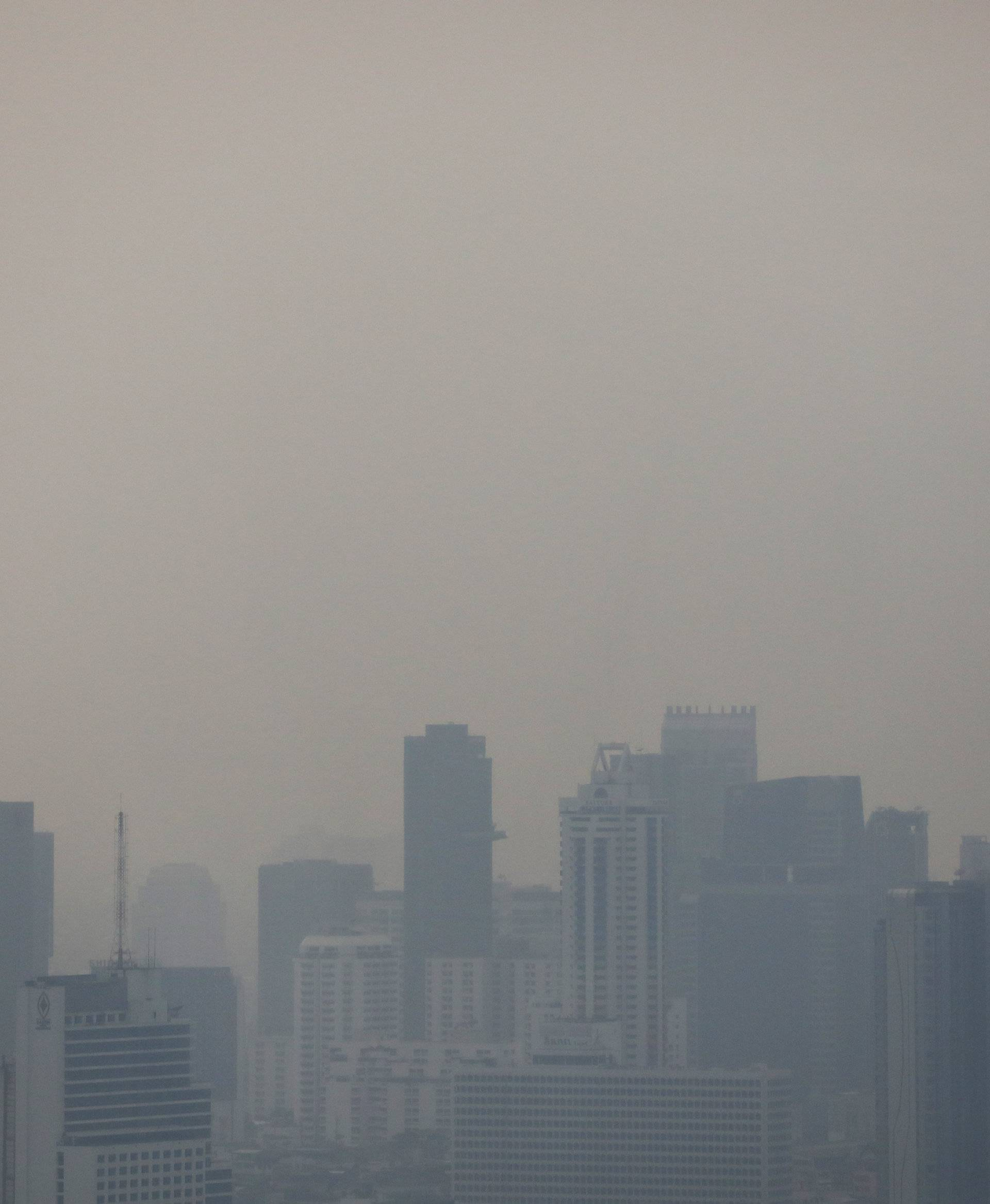 Skyline is seen through polluted air during in Bangkok