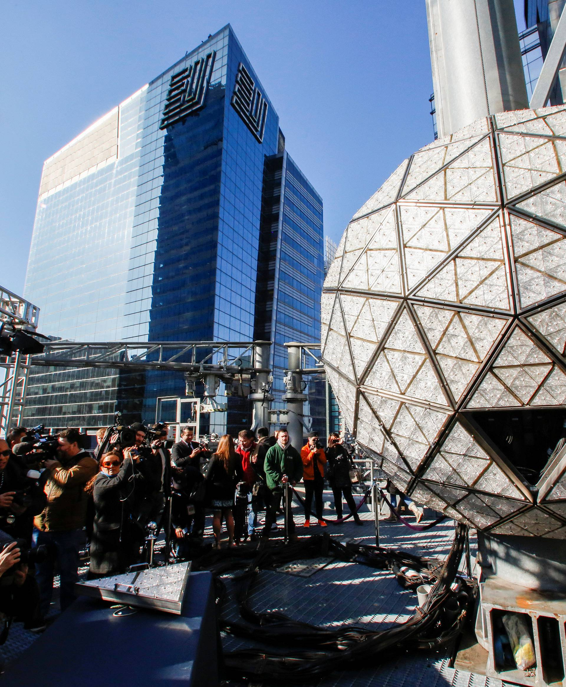 Media try to take a look of the Waterford Crystal triangles on the Times Square New Year's Eve Ball on the roof of One Times Square in the Manhattan borough of New York