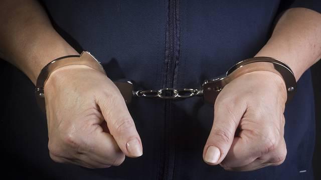 Handcuffed female hands
