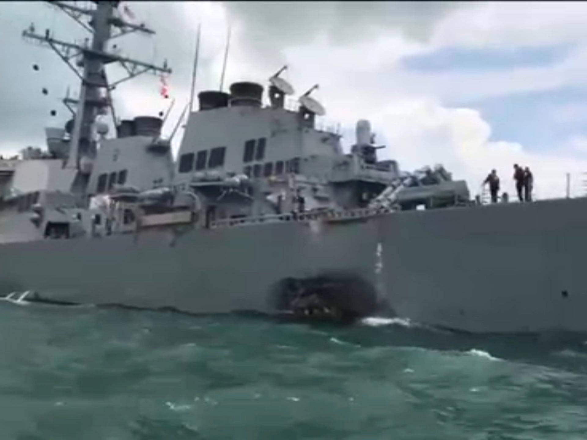 The U.S. Navy guided-missile destroyer USS John S. McCain is seen after a collision, in Singapore waters in this still frame taken from video