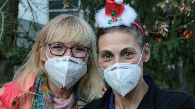 Nurses of a home for the elderly wear face masks as they attend a Christmas party in the backyard of the St. Martha retirement home as the coronavirus disease (COVID-19) outbreak continues in Speyer