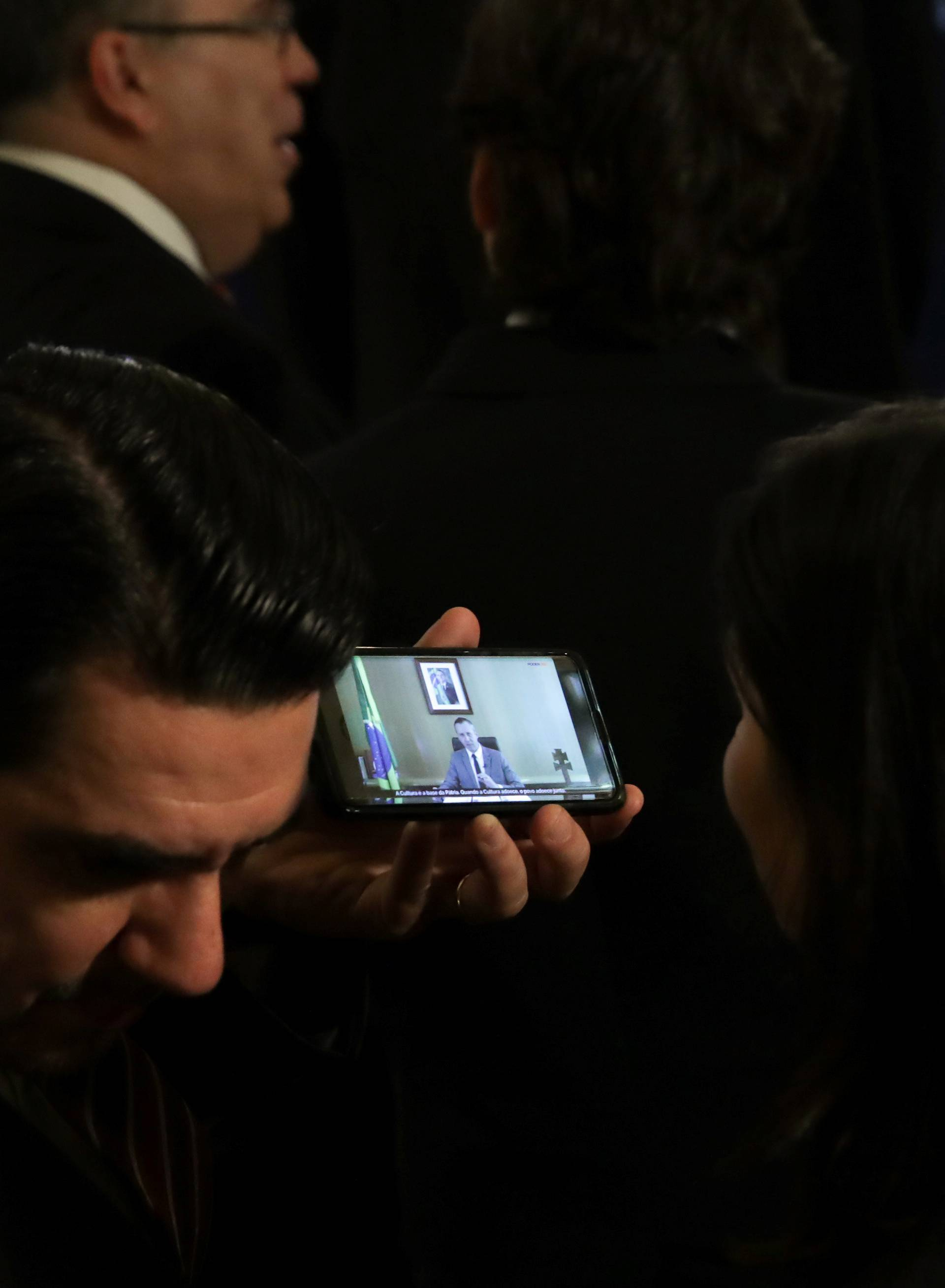 Diplomats watch a video of controversial remarks by Brazil's Culture Secretary Alvim as they gather at the Organization of American States for remarks by U.S. Secretary of State Pompeo at the OAS in Washington