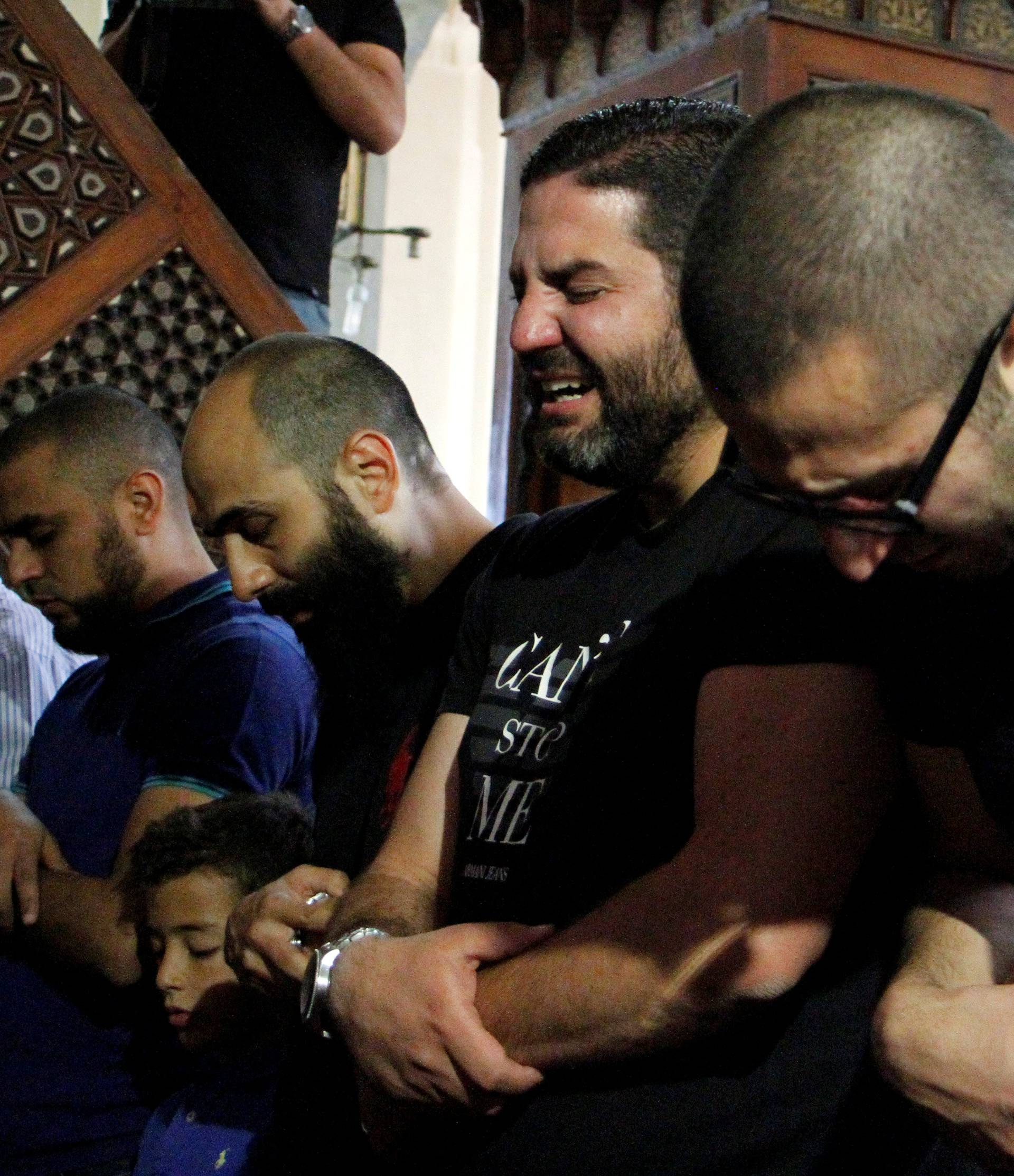 Relatives of the victims of the missing EgyptAir flight MS804 hold an absentee funeral prayer in a mosque nearby Cairo airport, in Cairo
